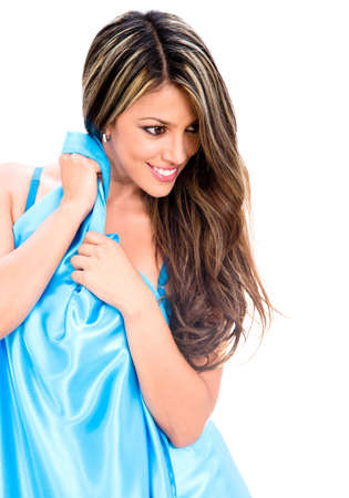 Beautiful woman wrapped in a blue dress - isolated over white Stock Photo - 18024500