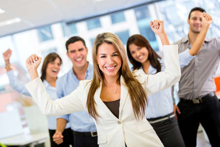 Successful business team with arms up at the office Stock Photo - 18055409