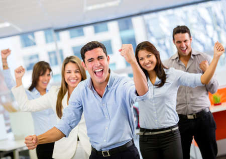 team victory: Business team celebrating a triumph with arms up Stock Photo