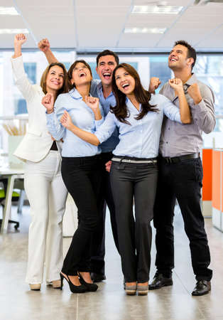 Business group with arms up celebrating their success Stock Photo - 18055406
