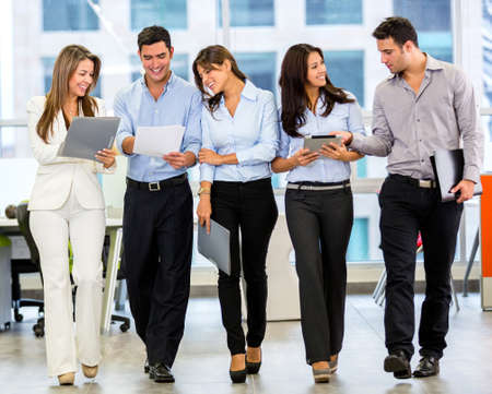 Business team working at the office looking very happy Stock Photo - 18055413