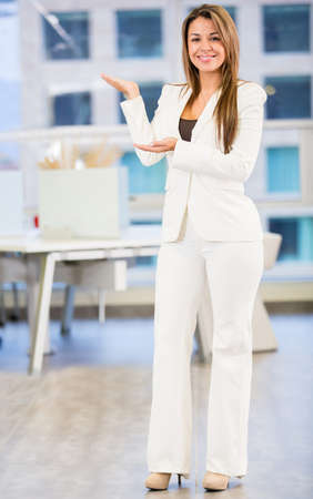 Welcoming business woman looking happy at the office Stock Photo - 18055404