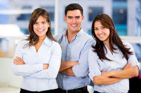 Successful business team at the office with arms crossed Stock Photo - 18055416
