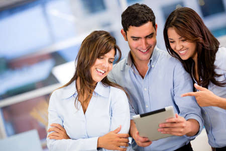 Group of business people working with a tablet computer Stock Photo - 18055408