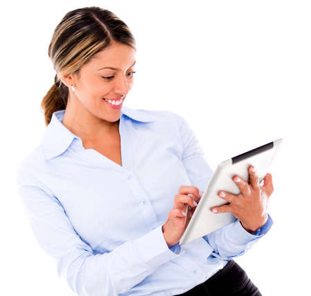 Business woman using a tablet computer - isolated over a white background Stock Photo - 18055421