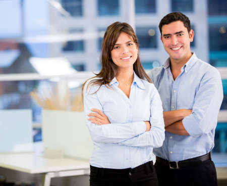 Successful business team with arms crossed at the office Stock Photo - 18096727