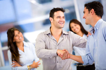 Handshake of two business men closing a deal at the office Stock Photo - 18096723