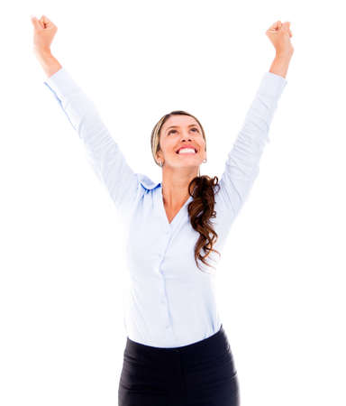 Excited business woman with arms up celebrating - isolated over a white background photo