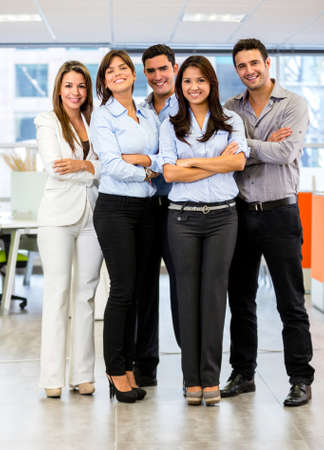 Confident business group looking happy at the office photo