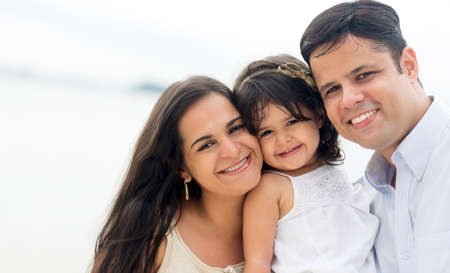 Beautiful family on holidays looking very happy outdoors Stock Photo - 18489644