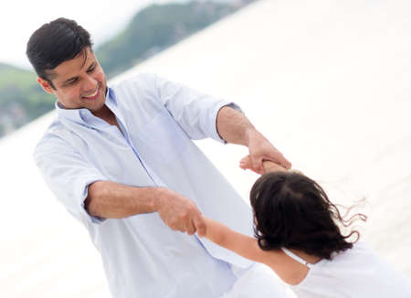 Happy father playing with his daughter at the beach Stock Photo - 18489648