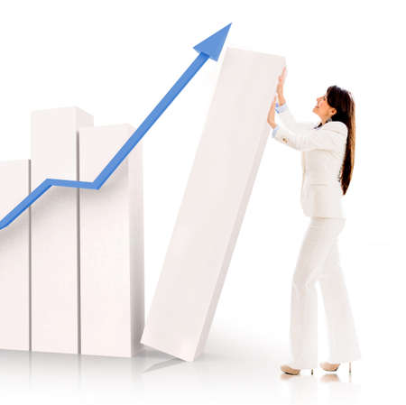 financial growth: Successful business woman pushing a bar graph - isolated over white