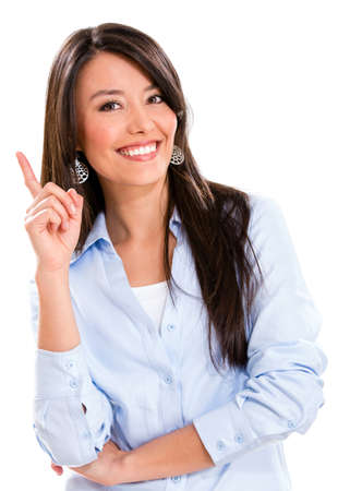woman pointing: Business woman pointing an idea and smiling - isolated over white