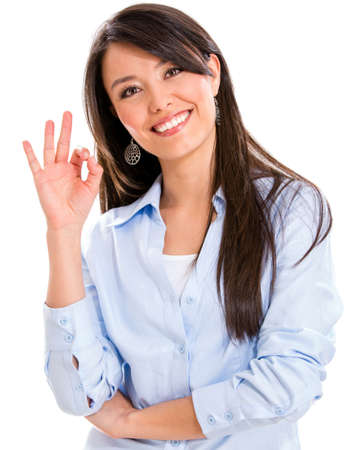 alright: Business woman with an ok sign - isolated over a white background