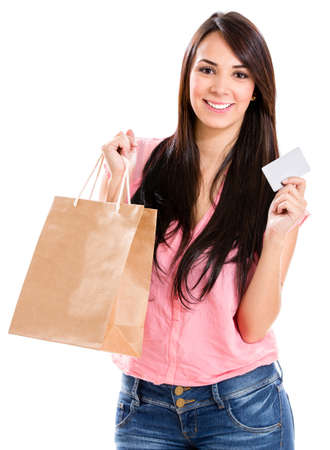 hispanic: Happy woman shopping with a credit card - isolated over white