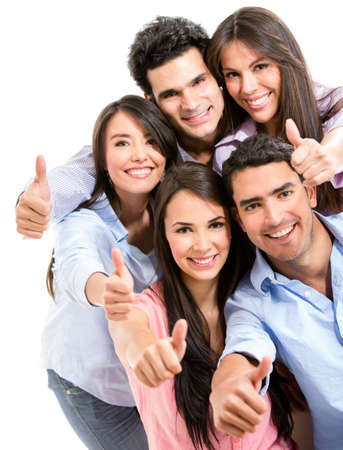 Group of friends with thumbs up - isolated over white photo