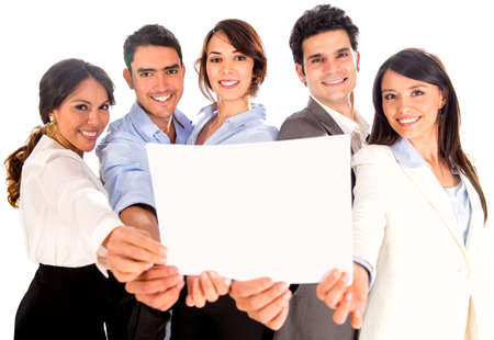 Business team holding a banner or document - isolated over white photo
