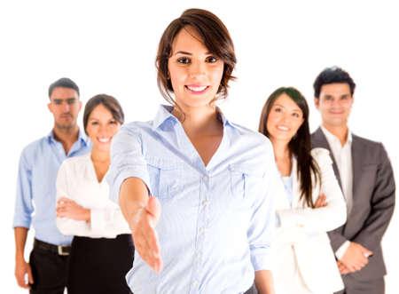 jonge ondernemers: Zakelijke vrouw met de hand uitgebreid tot handdruk - geà ¯ soleerd over white Stockfoto