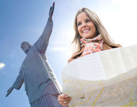 disoriented: Happy woman traveling to Rio de Janeiro and holding a map