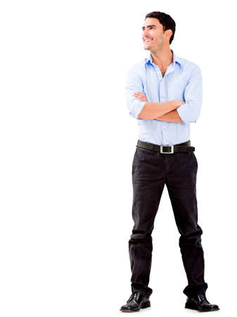 casual attire: Confident business man with arms crossed - isolated over