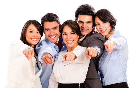 Happy business group pointing at the camera - isolated over white photo