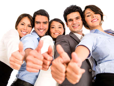 positive positivity: Happy business team with thumbs up - isolated over a white background