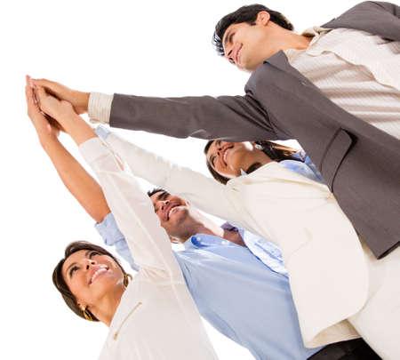 personas festejando: Grupo de hombres de negocios que celebran su trabajo en equipo con un m�ximo de cinco