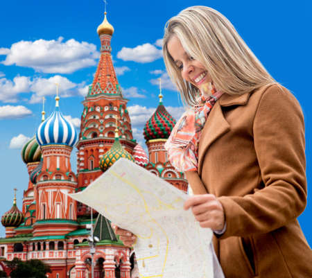 disoriented: Happy woman seightseeing in Moscow and holding a map
