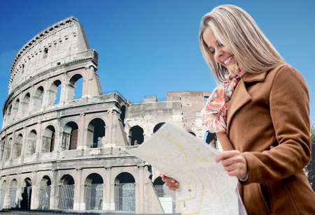 Happy female tourist in Rome holding a map Stock Photo - 18568770