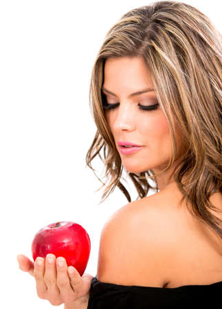 Beautiful woman with an apple - isolated over a white background Stock Photo - 18561638