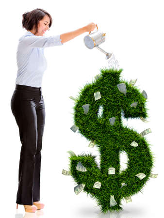 Business woman watering money plant - isolated over a white background photo