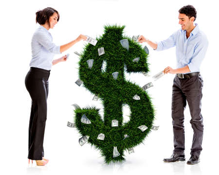 young entrepreneurs: Business people with a money plant - isolated over white