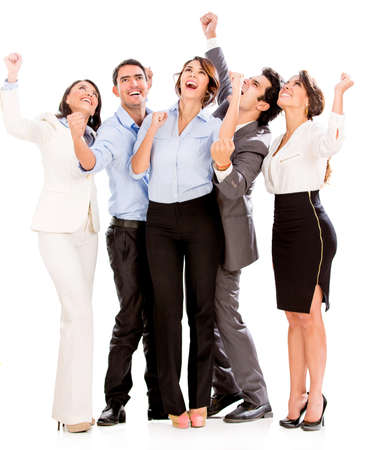 Successful business team with arms up - isolated over white photo