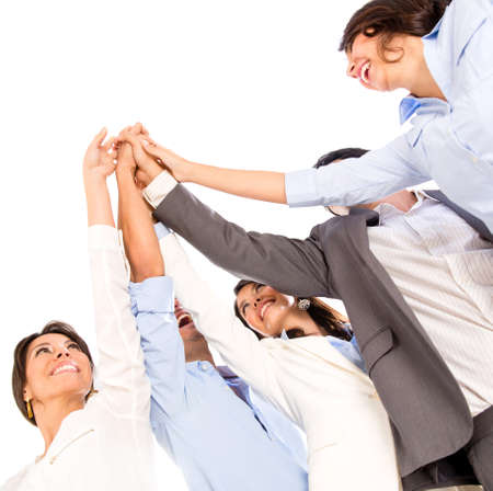 people celebrating: Business group celebrating their teamwork with a high five - isolated over white
