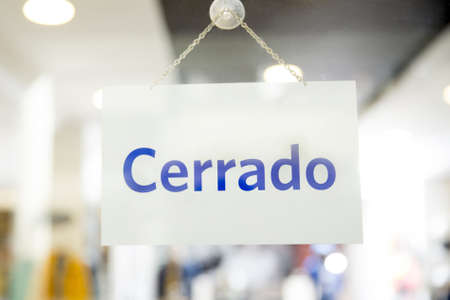 Spanish closed sign hanging in a retail store Stock Photo - 18585721