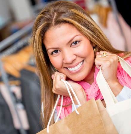 Happy woman shopping at the mall and holding bags Stock Photo - 18572352