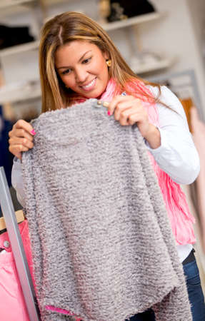 Woman shopping for clothes at a retail store Stock Photo - 18572353