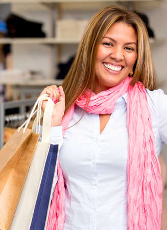 Very happy female shopper smiling at the store Stock Photo - 18572360