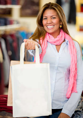Happy woman holding shopping bags and smiling Stock Photo - 18572357