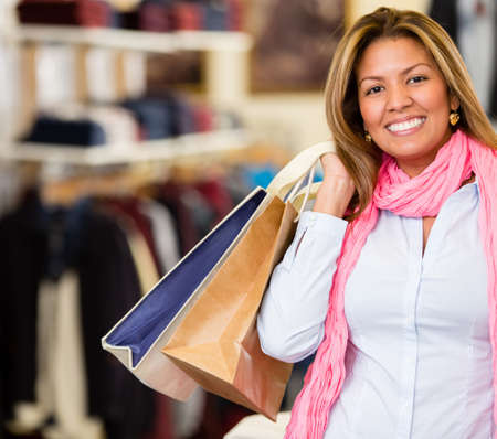 Happy woman shopping holding bags and smiling Stock Photo - 18572350