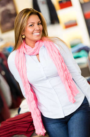 Shopping woman at a clothing store looking very happy Stock Photo - 18572355