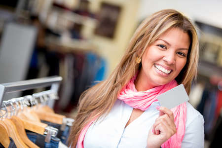 Happy woman shopping with a credit card in a retail store Stock Photo - 18572356