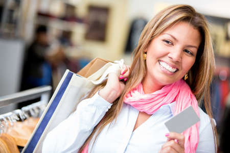 Female shopper with a credit card looking very happy photo