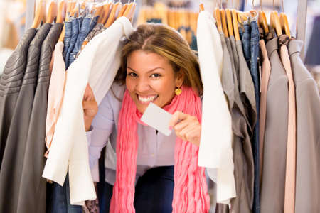 Very happy shopping woman holding a credit card at the store Stock Photo - 18572348