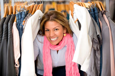 Happy shopping woman buying clothes in a store Stock Photo - 18572361