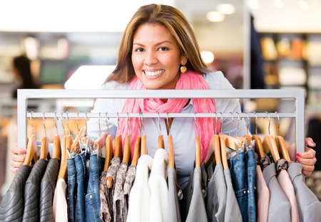 Beautiful woman buying clothes and looking very happy Stock Photo - 18572351
