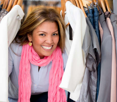 Happy female shopping for clothes at a retail store Stock Photo - 18706412