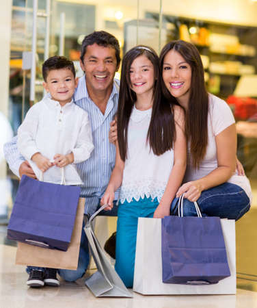 Family at the shopping center looking very happy photo