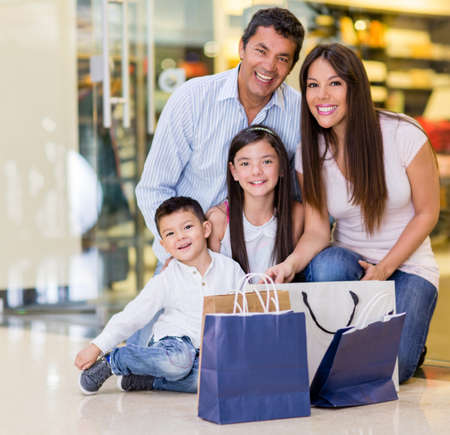 Beautiful family shopping at the mall and looking very happy photo