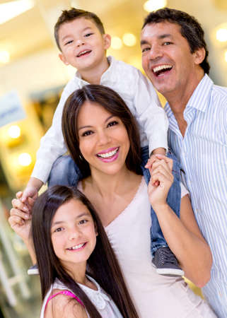 Beautiful happy family at the shopping center photo